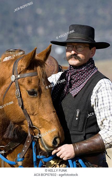 Cowboy and horse at Douglas Lake Ranch, British Columbia, Canada