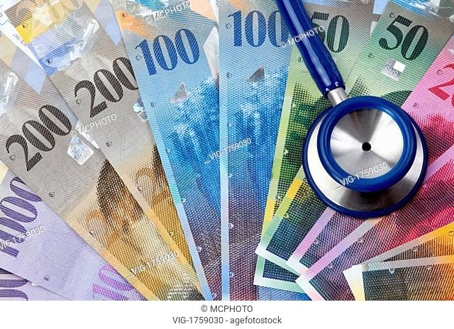 Swiss Franc and stethoscope, symbol, health costs - 31/07/2009