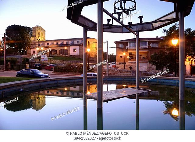 Pool and church of Asuncion in Pelayos de la Presa, Madrid, Spain