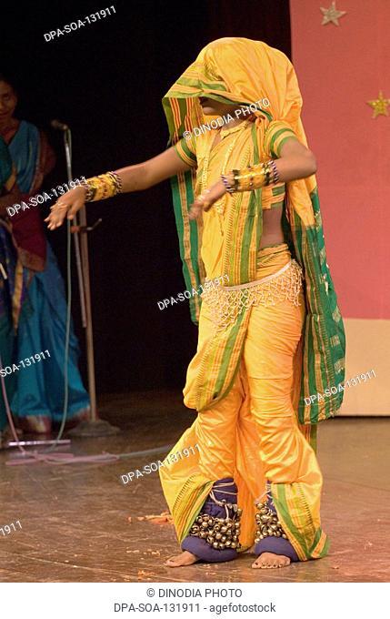 Woman performing traditional folk dance Lavani ; Maharashtra ; India NO MR