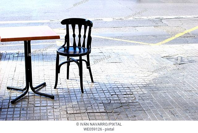 Table and chair on the street
