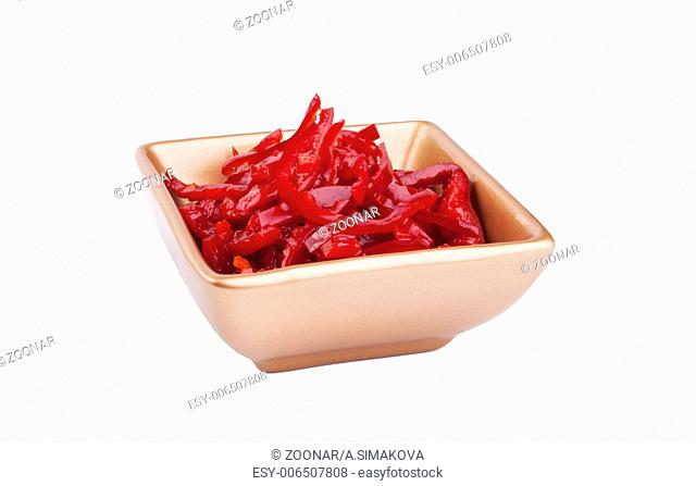 Red hot chili pepper in olive oil served in golden bowl