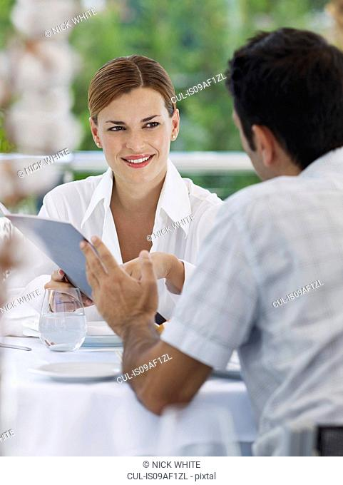 Couple choosing from menu in hotel restaurant