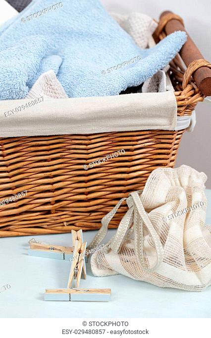 Handmade painted clothespins in the bag, towels, and a basket