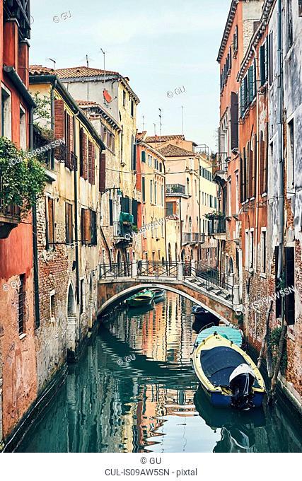 Bridge over narrow canal, Venice, Italy