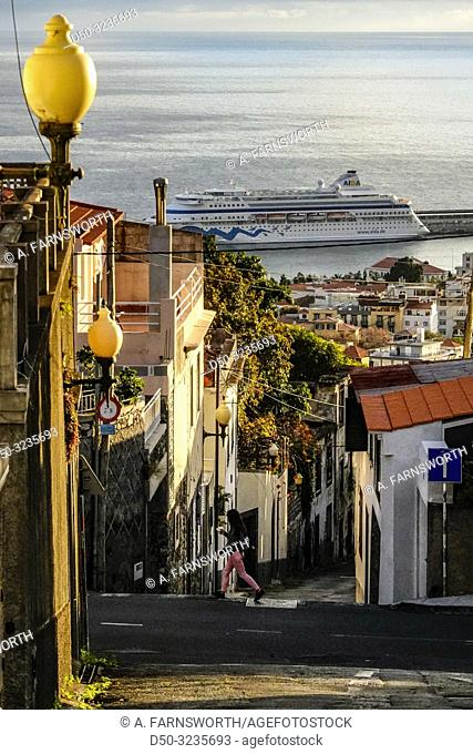 Funchal, Madeira, Portugal An old street lamp with views over the port and the Old Town