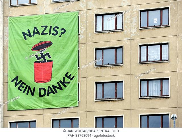 A banner which reads 'Nazis? Nein Danke' ('Nazis? No, thanks') is attached to a house during a protest against a rally by right-wing extremists in Plauen