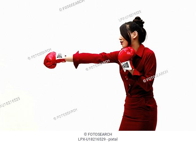 Young Woman in Red Punching, Side View
