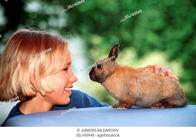 girl with pygmy rabbit