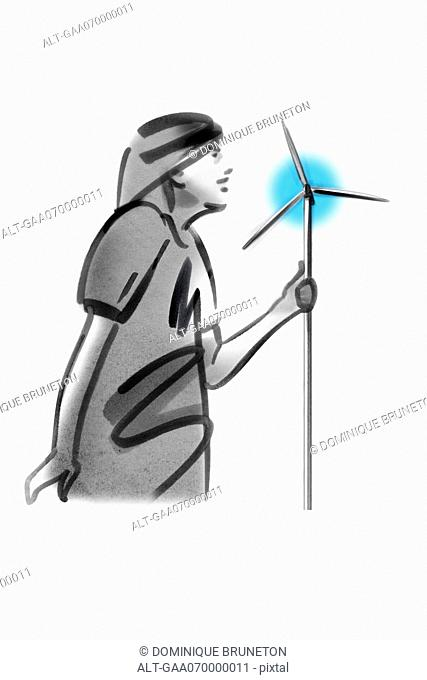 Person holding pinwheel resembling wind turbines