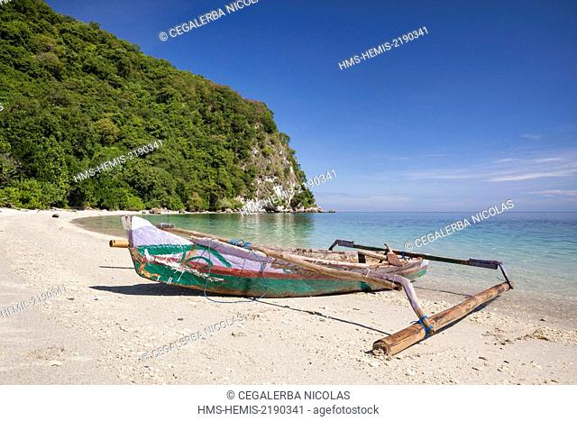 Indonesia, Lesser Sunda Islands, Alor Island, Batu Putih, boat laid on the sand on the Batu Putih beach (the white stone)