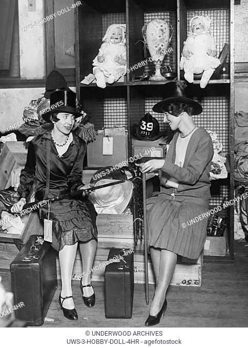 New York, New York: c. 1928 Two women check out some of the items for sale, including two large dolls up above at the U.S