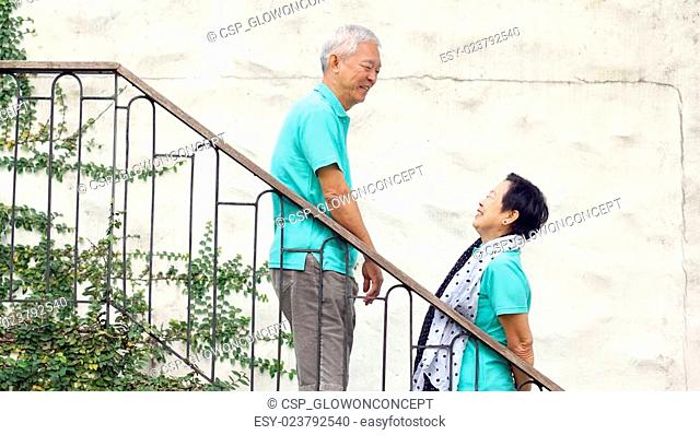 Asian senior couple travel for anniversary trip