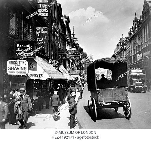 The Strand looking east, Westminster, London, (c1910s?). Reid, an amateur photographer of independent means, began an ambitious project to record