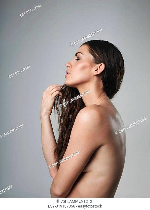 Nude female model on grey background