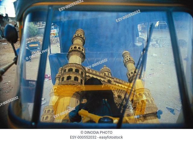 Reflection of Charminar in glass , Hyderabad , Andhra Pradesh , India