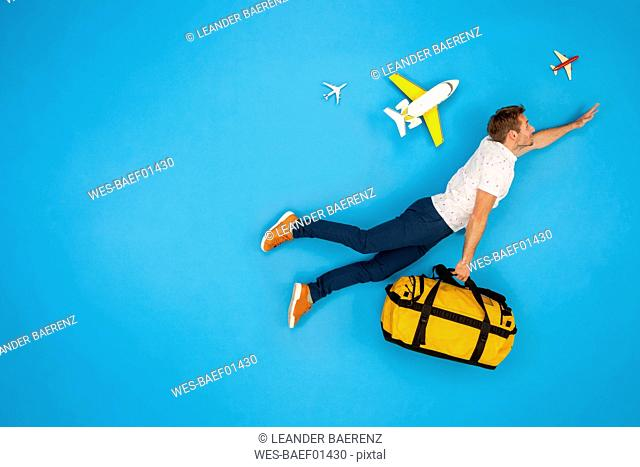 Man with suitcase hurrying to to get his flight