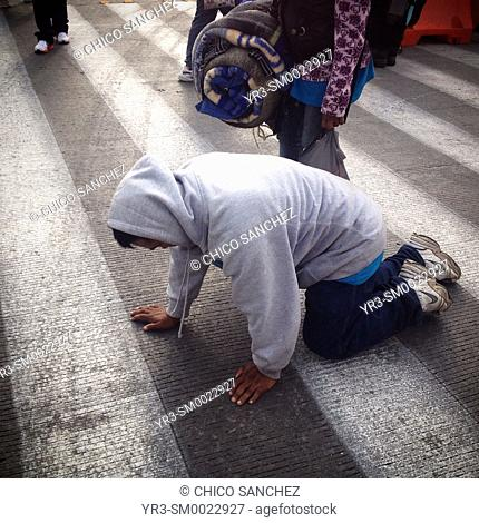 A man walks on his knees during the annual pilgrimage to the Basilica of Our Lady of Guadalupe in Mexico City, Mexico