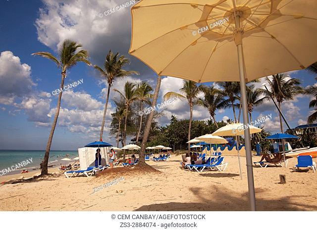 Scene from the Santa Maria del Mar beach with umbrellas in the foreground, Playas del Este, La Habana, Cuba, West Indies, Central America
