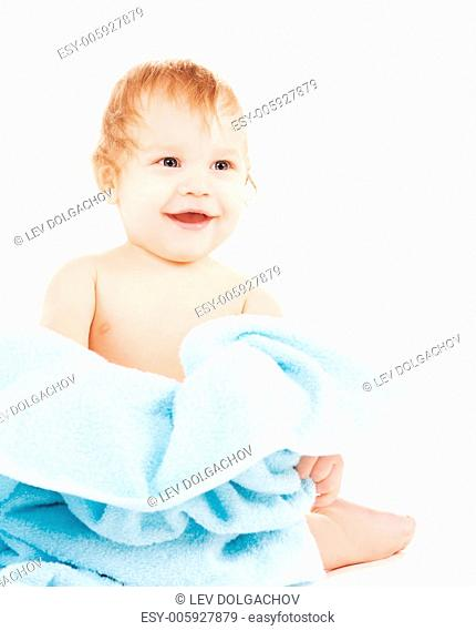 picture of baby boy with blue towel over white