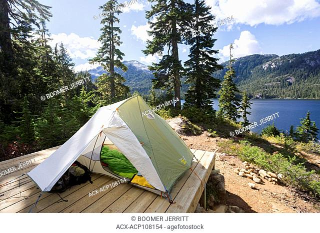 A tent setup overlooks Bedwell Lake in Strathcona Park on Central Vancouver Island. Strathcona Park, Vancouver Island, British Columbia, Canada