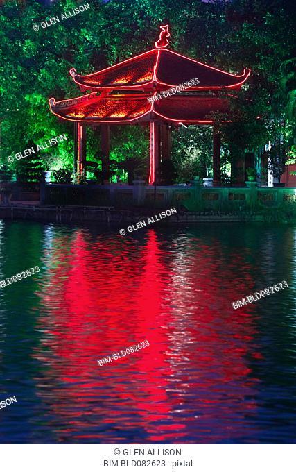Colorful Vietnamese pagoda near water