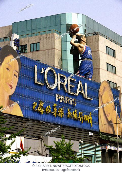 Signs showing new advertising culture and foreign brands. Beijing, China