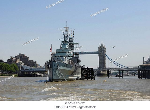 HMS Belfast and Tower Bridge on the River Thames. HMS Belfast is the last surviving British big-gun warship of World War 2, having served in the D-Day landings