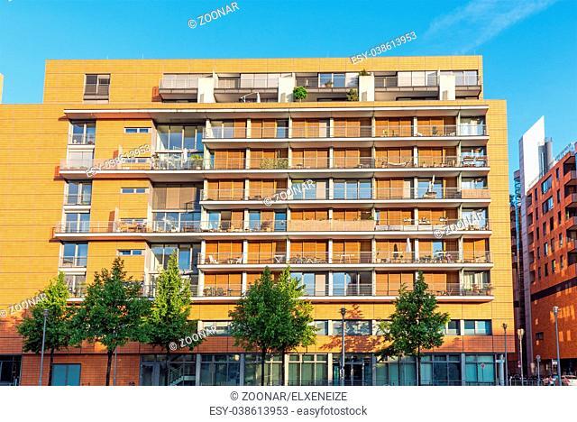 Modern orange apartment house seen in Berlin, Germany