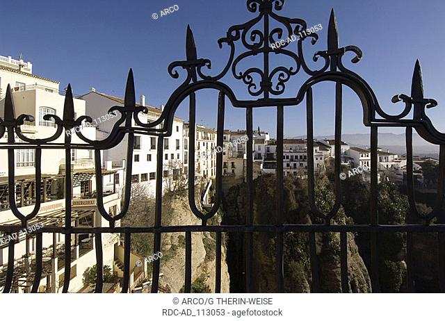 View through wrought-iron fence over El Mercadillo and El Tajo new part of the City of Ronda Andalusia Spain