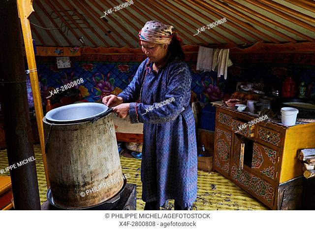 Mongolia, Arkhangai province, nomad woman distilling milk alcohol the in the yurt