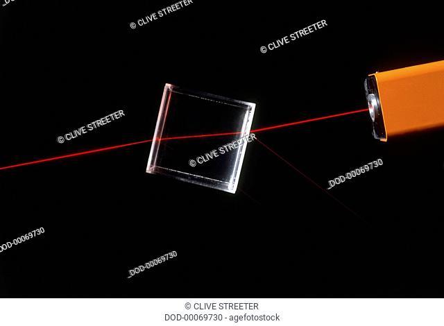 Beam of light refracting through glass