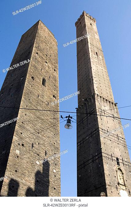 Low angle view of stone towers in city