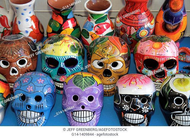Mexico, Yucatán Peninsula, Quintana Roo, Cancun, business, Mercado 28, souvenirs, shopping, vendor stall, clay masks, vases, skeletons, calaveras, tradition