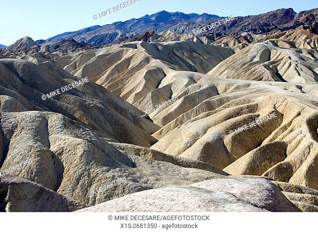 Precarious ridge top hiking trails follow the sandstone formations at Zabriskie Point in Death Valley