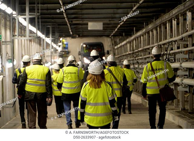 STOCKHOLM, SWEDEN Contruction workers and guests in a biomass electricity producing plant