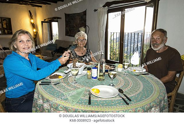 Sitting at the table to eat. Alpujarras, Spain