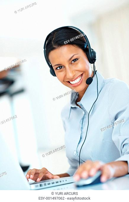 Beautiful call center employee using laptop at office