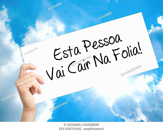 Esta Pessoa Vai Cair Na Folia! (This Person Will be at Carnaval in Portuguese) Sign on white paper. Man Hand Holding Paper with text