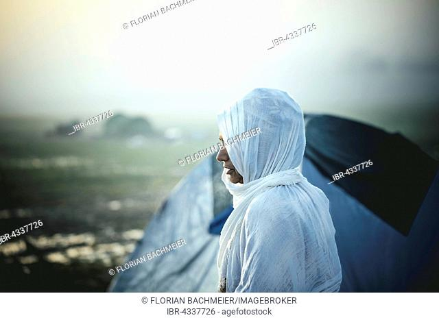 Woman in front of tent, refugee camp Idomeni on the Greek-Macedonian border, Greece