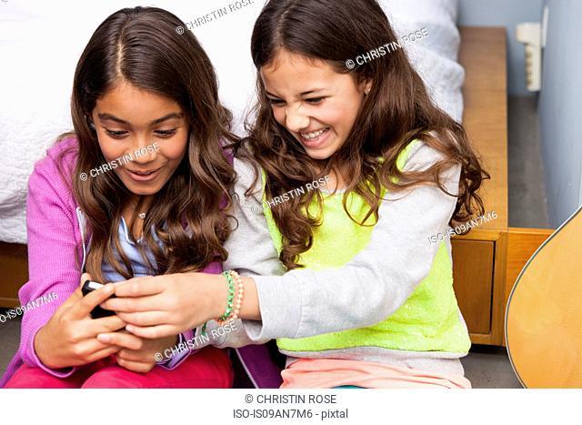 Three girls using smartphone