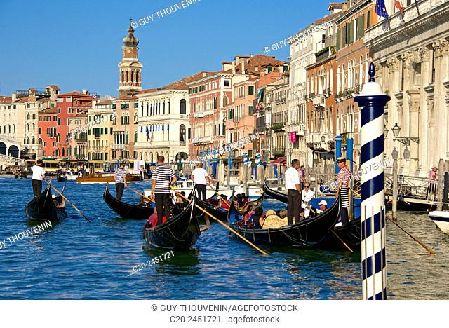 Gondolas and gondoliers, Palaces facades, church steeple, Canal Grande, Venice, Venetia, Italy