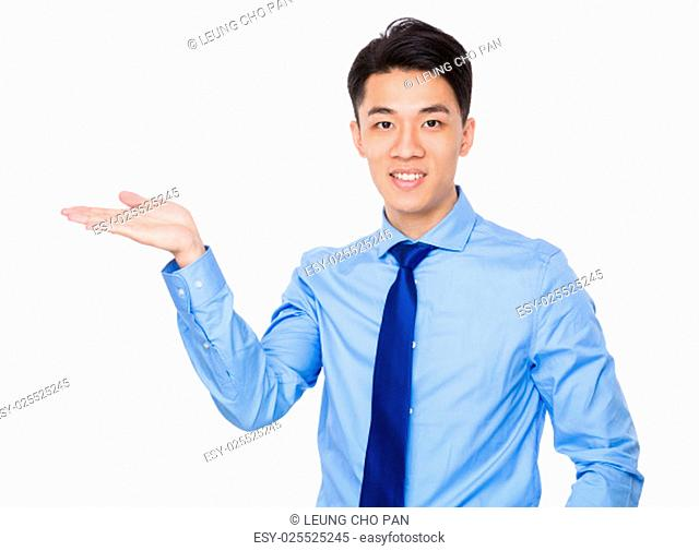 Young businessman with hand showing blank sign