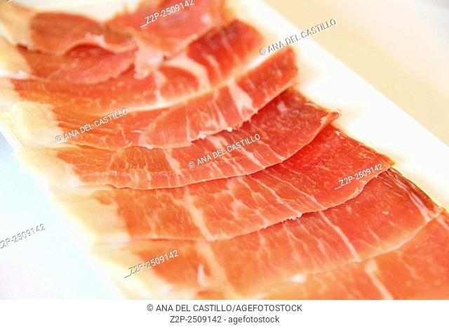 closeup of a plate with spanish serrano ham served as tapas