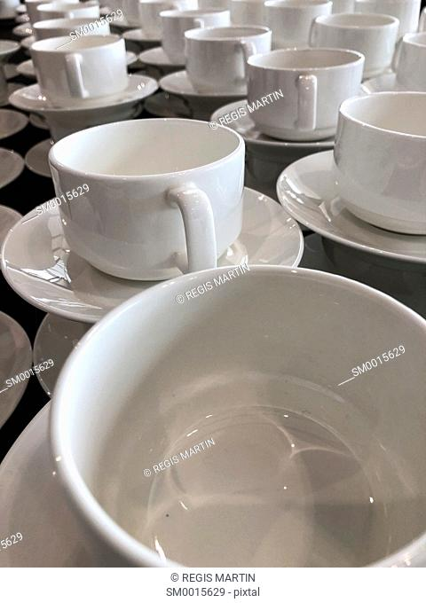 White empty ceramic cups at a buffet