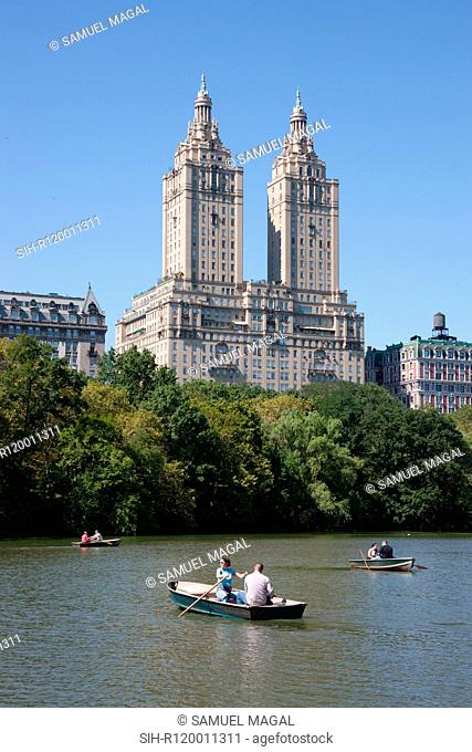 USA, New York, Central Park, The Lake and San Remo apartments in the background
