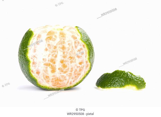 Slice of fresh tangerine isolated on white background