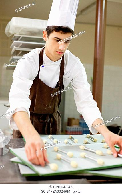 Baker making cookies in kitchen
