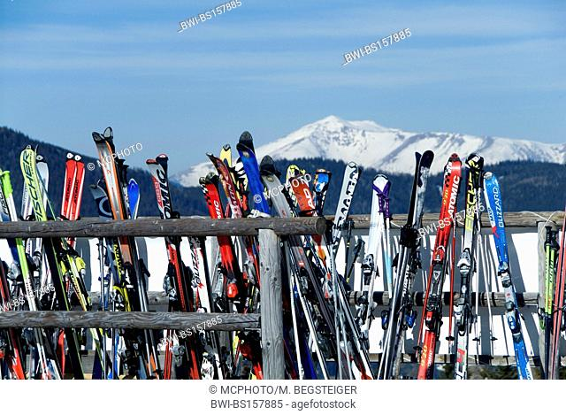 skis leaned against a wooden fence, Austria, Styria