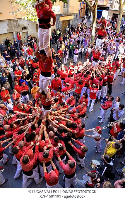 Nens del Vendrell and Colla Joves Xiquets de Valls 'Castellers' building human tower, a Catalan tradition Fira de Santa Teresa